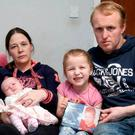 From left: Jayden, Leanne, baby Ellianna, Amelia and Darrel Fleck in their home