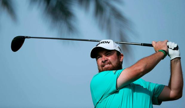 Shane Lowry of Ireland tees off on the 11th hole in round three of the Abu Dhabi Championship golf tournament in Abu Dhabi, United Arab Emirates
