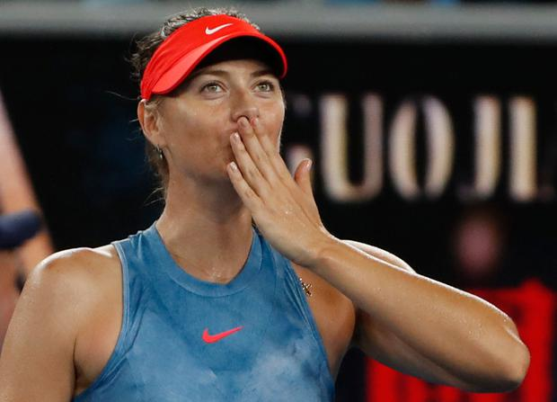 Maria Sharapova seals it with a kiss. Photo: Reuters