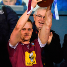 Westmeath captain Killian Daly lifts the Bord na Móna O'Byrne Cup trophy after beating Dublin in Parnell Park. Photo: Sportsfile