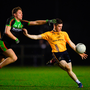 David Garland of DCU Dóchas Éireann in action against Eoin Buggie of IT Carlow. Photo: Sportsfile