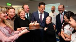 Birthday boy: Leo Varadkar gets a cake from DCU students and staff including Denise Hosford from HeadstARTS who gave him a hug
