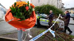 Flowers at the scene at Gym Plus in Applewood Close, Swords where two men were shot, one fatally, on Thursday night. PHOTO: COLIN KEEGAN