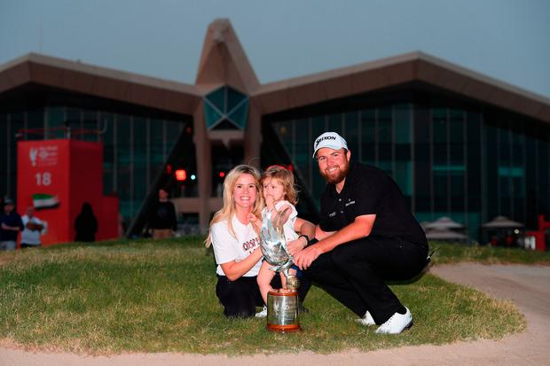 ABU DHABI, UNITED ARAB EMIRATES - JANUARY 19: Shane Lowry of Ireland celebrates with wife Wendy Honner, daughter Iris Lowry and the trophy after winning during Day Four of the Abu Dhabi HSBC Golf Championship at Abu Dhabi Golf Club on January 19, 2019 in Abu Dhabi, United Arab Emirates. (Photo by Ross Kinnaird/Getty Images)