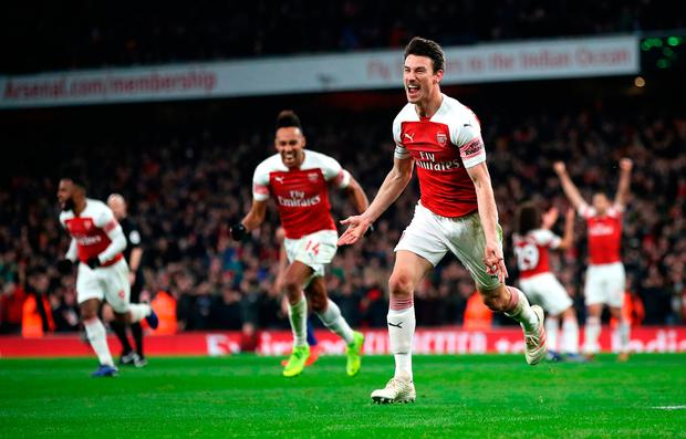 Arsenal's Laurent Koscielny (right) celebrates scoring his side's second goal of the game during the Premier League match at The Emirates Stadium, London. Saturday January 19, 2019. Nick Potts/PA Wire.