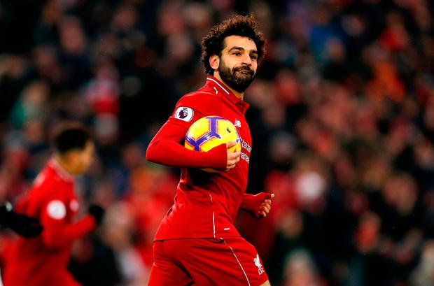 Liverpool's Mohamed Salah celebrates scoring his side's first goal of the game during the Premier League match at Anfield, Liverpool. PRESS ASSOCIATION Photo. Picture date: Saturday January 19, 2019. Darren Staples/PA Wire.