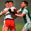 Tyrone's Ryan Gray is put under pressure by Fermanagh duo Aidan Breen and Conor McHugh during the recent McKenna Cup match in Omagh. Photo: Oliver McVeigh/Sportsfile