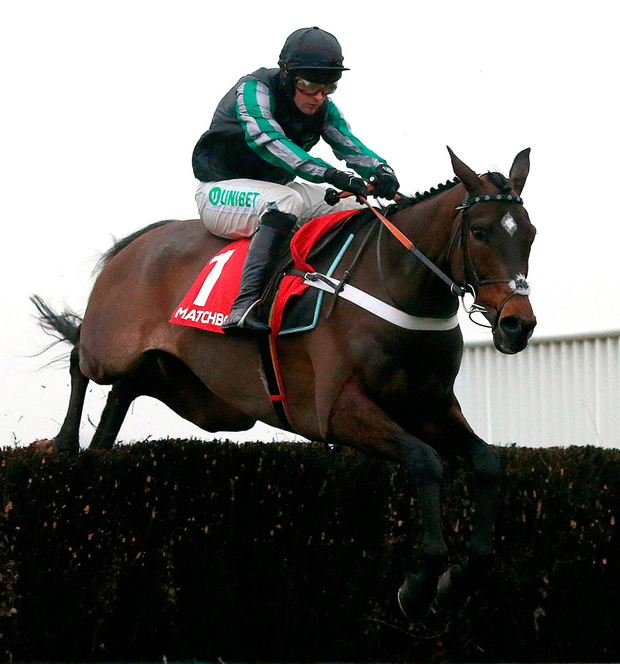 Altior ridden by Nico de Boinville clear a fence before winning The Matchbook Clarence House Steeple Chase Race at Ascot. Photo: Julian Herbert/PA