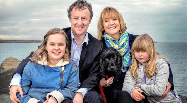 Newstalk presenter Tom Dunne at the seafront in Glasthule with his wife Audrey, daughters Eva and Skye and the family's dog, Murph. Photo: Tony Gavin