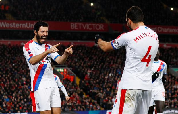Crystal Palace's James Tomkins celebrates scoring his side's second goal with Luka Milivojevic. Photo: Reuters
