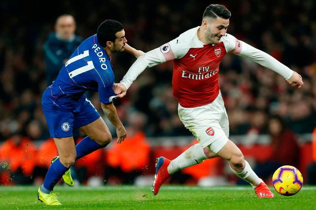 Arsenal's Sead Kolasinac battles for the ball with Chelsea's Pedro. Photo: Getty Images
