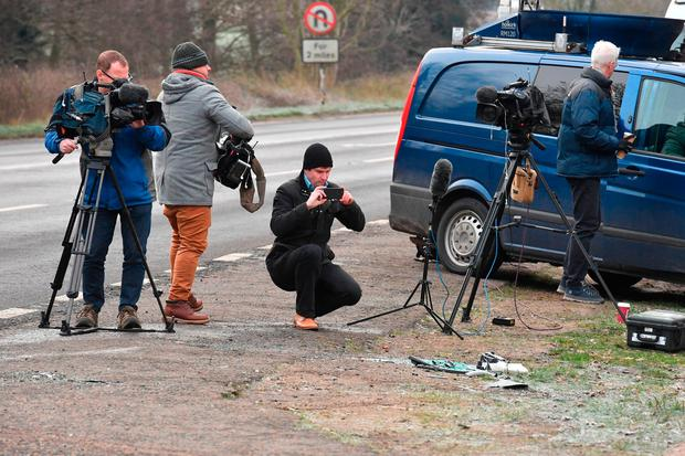 Media film broken glass and car parts on the side of the A149 near to the Sandringham Estate where the Duke of Edinburgh was involved in a road accident. Picture date: Friday January 18, 2019. John Stillwell/PA Wire