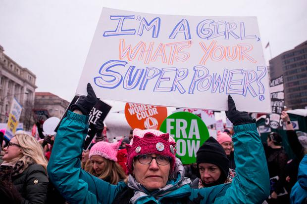 A demonstrator holds a sign during the 2019 Women's March on January 19, 2019 in Washington, DC. (Photo by Zach Gibson/Getty Images)