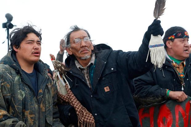 Nathan Phillips (C) prays with other protesters near the main opposition camp against the Dakota Access oil pipeline near Cannon Ball, North Dakota, U.S., February 22, 2017. Picture taken February 22, 2017. REUTERS/Terray Sylvester