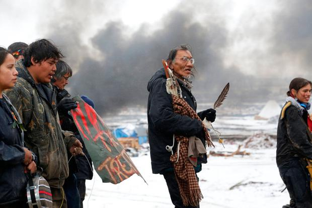 Nathan Phillips (C) marches with other protesters out of the main opposition camp against the Dakota Access oil pipeline near Cannon Ball, North Dakota, U.S., February 22, 2017. Picture taken February 22, 2017. REUTERS/Terray Sylvester