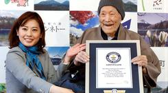 Japanese Masazo Nonaka, who was born 112 years and 259 days ago, receives a Guinness World Records certificate naming him the world's oldest man during a ceremony in Ashoro, on Japan's northern island of Hokkaido, in this photo taken by Kyodo April 10, 2018. Nonaka died at the age of 113 on January 20, 2019, local media reported. credit Kyodo/via REUTERS/File Photo