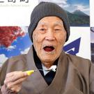 Japanese Masazo Nonaka, who was born 112 years and 259 days ago, eats his favorite cake as he receives a Guinness World Records certificate naming him the world's oldest man during a ceremony in Ashoro, on Japan's northern island of Hokkaido, in this photo taken by Kyodo April 10, 2018.Kyodo/via REUTERS