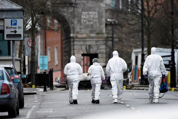 Forensic officers arrive at the scene of a suspected car bomb in Derry, January 20, 2019. REUTERS/Clodagh Kilcoyne