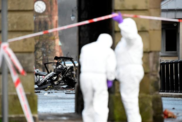 Forensic officers inspect the scene of a suspected car bomb in Derry, January 20, 2019. REUTERS/Clodagh Kilcoyne
