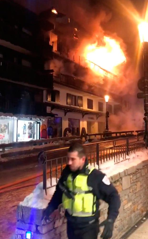 A first responder walks near the scene of a fire at Courchevel ski resort, France January 20, 2019 in this still image taken from social media video. Georgis Kelli via REUTERS