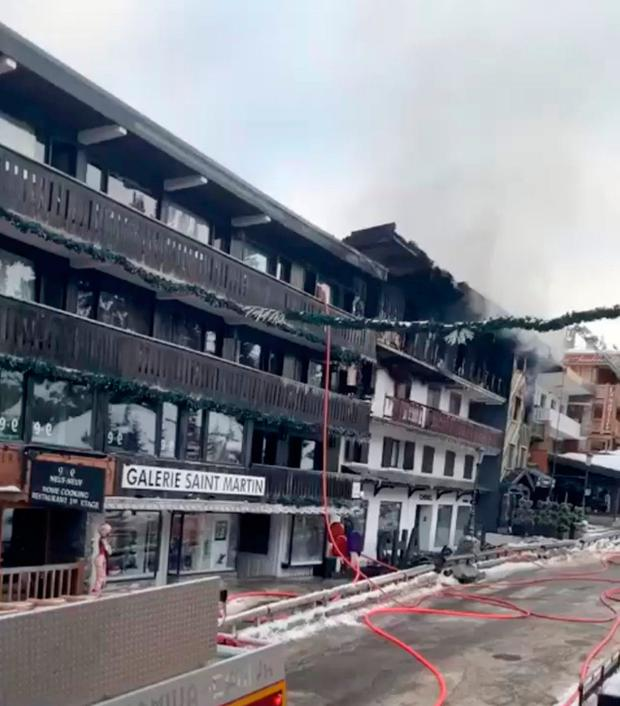 Smoke rises from a building after a fire at Courchevel ski resort, France January 20, 2019 in this still image taken from social media video. Jeremy via REUTERS