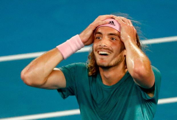 Tennis - Australian Open - Fourth Round - Melbourne Park, Melbourne, Australia, January 20, 2019. Greece's Stefanos Tsitsipas reacts after winning the match against Switzerland's Roger Federer. REUTERS/Edgar Su