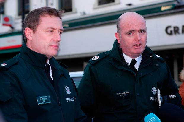 PSNI Superintendent Gordon McCalmont (left) and Assistant Chief Constable Mark Hamilton speak to the media near the scene of a car bomb blast on Bishop Street in Derry.Niall Carson/PA Wire
