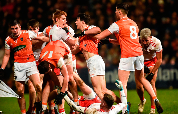 Players from both sides are involved in a tussle