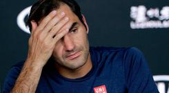 Switzerland's Roger Federer answers questions at a press conference following his fourth round loss to Greece's Stefanos Tsitsipas