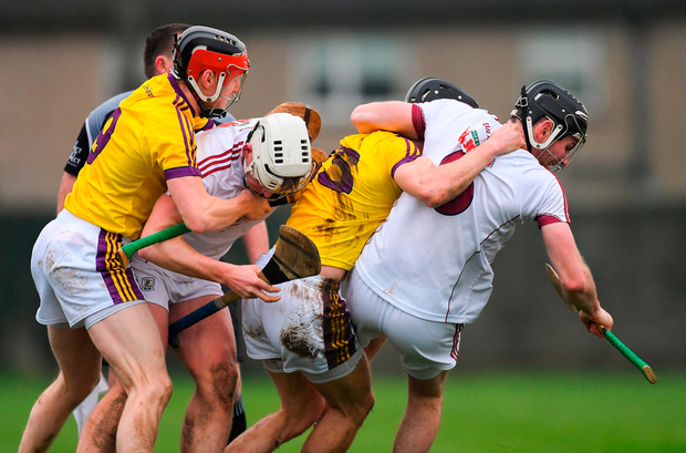 Getting a grip: Wexford's Diarmuid O'Keeffe (left) and Liam Óg McGovern in a tussle with Galway players Joe Mooney and Padraic Mannion (right) before Mannion and Wexford's Liam Ryan were both shown a straight red card by referee Seán Cleere. Photo by Piaras Ó Mídheach/Sportsfile