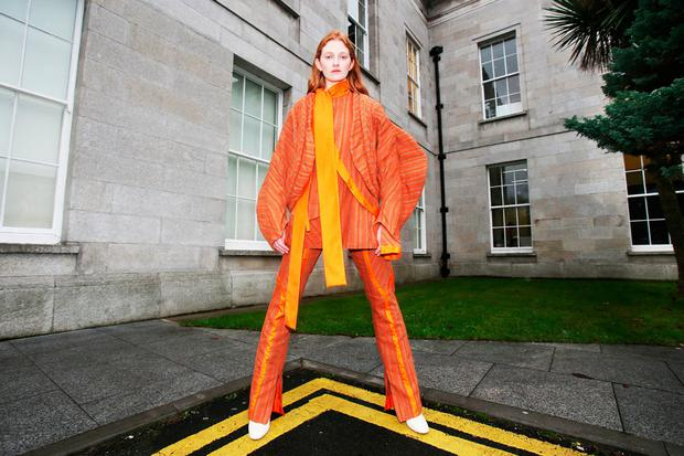 Aine O'Gorman modelling a suit by Richard Malone on day one of the Showcase trade fair. Photo: Leon Farrell/Photocall Ireland.