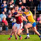 No way past: Roscommon pair Evan McGrath and Niall Kilroy (right) stop Johnny Heaney of Galway in his tracks. Photo: Sam Barnes/Sportsfile