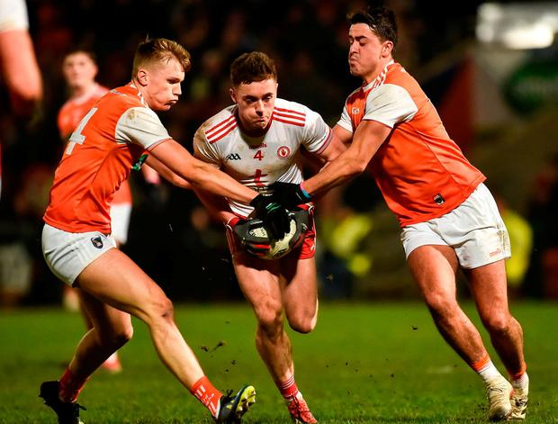 Tyrone's Liam Rafferty in action against Armagh's Rian O'Neill, left, and Stefan Campbell. Photo: Oliver McVeigh/Sportsfile