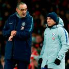 Chelsea boss Maurizio Sarri speaks with his assistant manager Gianfranco Zola during his team's defeat against Arsenal. Photo: Getty Images