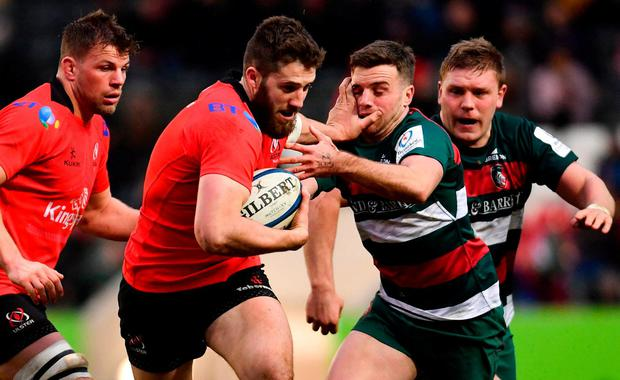 Ulster's Stuart McCloskey hands-off Leicester's George Ford at Welford Road. Photo: Ramsey Cardy/Sportsfile