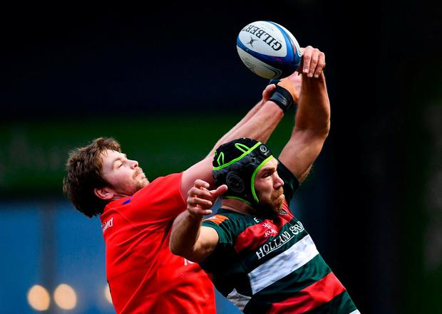 Graham Kitchener of Leicester Tigers wins possession in the lineout ahead of Iain Henderson of Ulster. Photo: Ramsey Cardy/Sportsfile