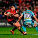 Joey Carbery of Munster in action against Joe Simmonds of Exeter Chiefs. Photo: Diarmuid Greene/Sportsfile