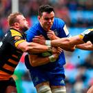 Leinster's James Ryan attempts to get through the combined efforts of Tom Cruse (left) and Josh Bassett during his team's victory against Wasps. Photo: Ramsey Cardy/Sportsfile