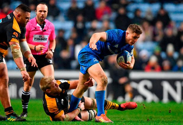 Leinster's Jordan Larmour is tackled by Wasps' Ben Morris. Photo: Ramsey Cardy/Sportsfile