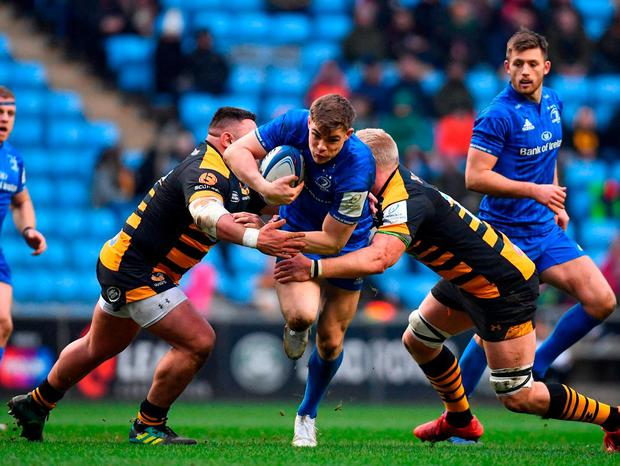Centre of excellence: Leinster's Garry Ringrose tries to break through the tackles of Wasps pair Zurab Zhvania and Ben Morris. Photo: Ramsey Cardy/Sportsfile