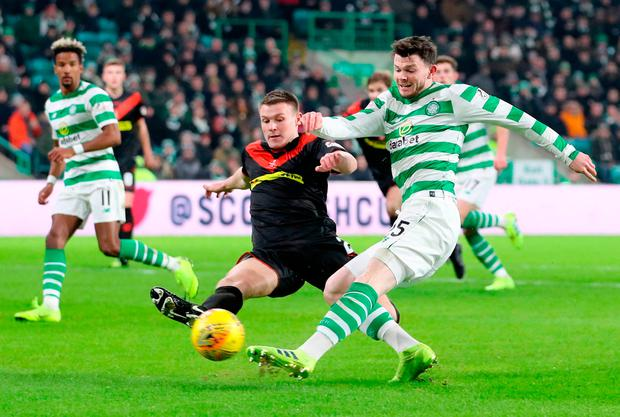 WORK TO DO: Celtic's Oliver Burke and Airdrie's Christopher O'Neil battle for the ball during Saturday's Scottish Cup fourth round match. Photo: Jane Barlow/PA Wire