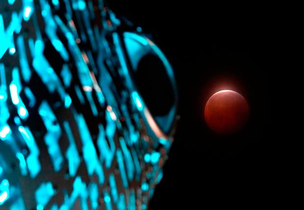 A super blood wolf moon next to the eye of one of The Kelpies near Falkirk during a lunar eclipse. Andrew Milligan/PA Wire