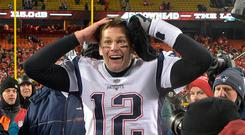 New England Patriots quarterback Tom Brady (12) reacts after defeating the Kansas City Chiefs during overtime in the AFC Championship game at Arrowhead Stadium. Credit: Jay Biggerstaff-USA TODAY Sports
