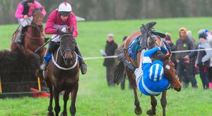 Jockey Mikey Sweeney (blue colours) performs a miracle to stay aboard Ask Heather. Photo credit: Healy Racing