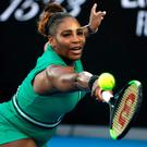 United States' Serena Williams makes a backhand return to Romania's Simona Halep during their fourth round match at the Australian Open tennis championships in Melbourne. (AP Photo/Kin Cheung)