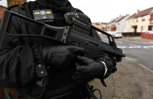 Armed policeman is seen at the scene of a security alert in Derry, Northern Ireland, January 20, 2019. REUTERS/Clodagh Kilcoyne