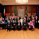 Historic: President Michael D Higgins and Sabina Higgins with a group of descendants of the members of the first Dáil Éireann at the Mansion House in Dublin. Photo: PA