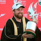 Shane Lowry celebrates with the trophy after his Abu Dhabi Championship victory. Photo: AP