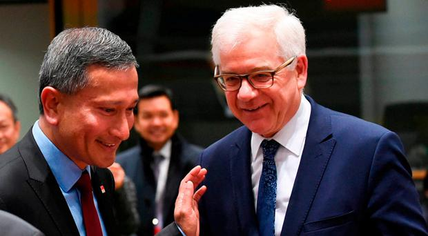Idea to 'solve matter': Polish Foreign Minister Jacek Czaputowicz (right). Photo: AFP/Getty Images