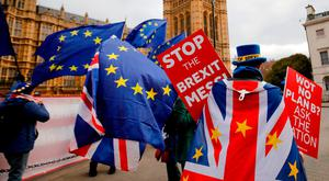 Protest: Anti-Brexit campaigners hold pro-EU placards and European community flags as they demonstrate in London yesterday. Photo: Tolga Akmen/AFP/Getty Images